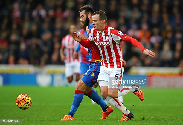 Joe Ledley of Crystal Palace and Glenn Whelan of Stoke City compete for the ball during the Barclays Premier League match between Stoke City and...