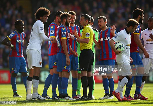 Joe Ledley of Crystal Palace confronts referee Michael Oliver with team mates after he gave a penalty for a Scott Dann hand ball during the Barclays...