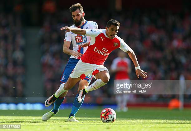 Joe Ledley of Crystal Palace fouls Alexis Sanchez of Arsenal during the Barclays Premier League match between Arsenal and Crystal Palace at the...
