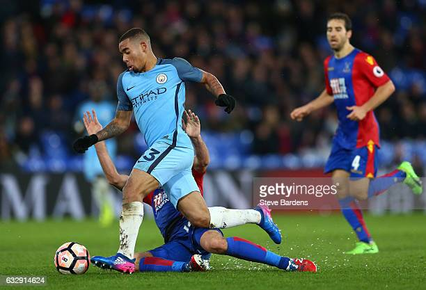 Joe Ledley of Crystal Palace tackles Gabriel Jesus of Manchester City during the Emirates FA Cup Fourth Round match between Crystal Palace and...