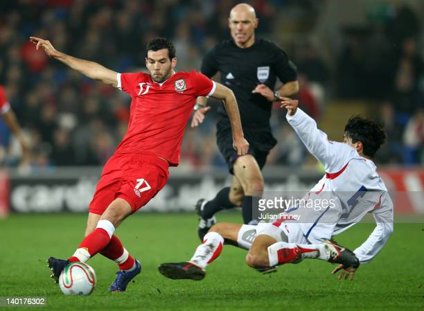 Joe Ledley of Wales is challenged by Jose Salvatierra of Costa Rica during the Gary Speed Memorial International Match between Wales and Costa Rica...