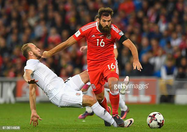 Joe Ledley of Wales is fouled by Valerian Gvilia of Georgia during the FIFA 2018 World Cup Qualifier Group D match between Wales and Georgia at...