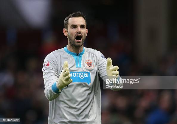 Joe Lewis of Blackpool gesticulates during the FA Cup Third Round Match between Aston Villa and Blackpool at Villa Park on January 4 2015 in...