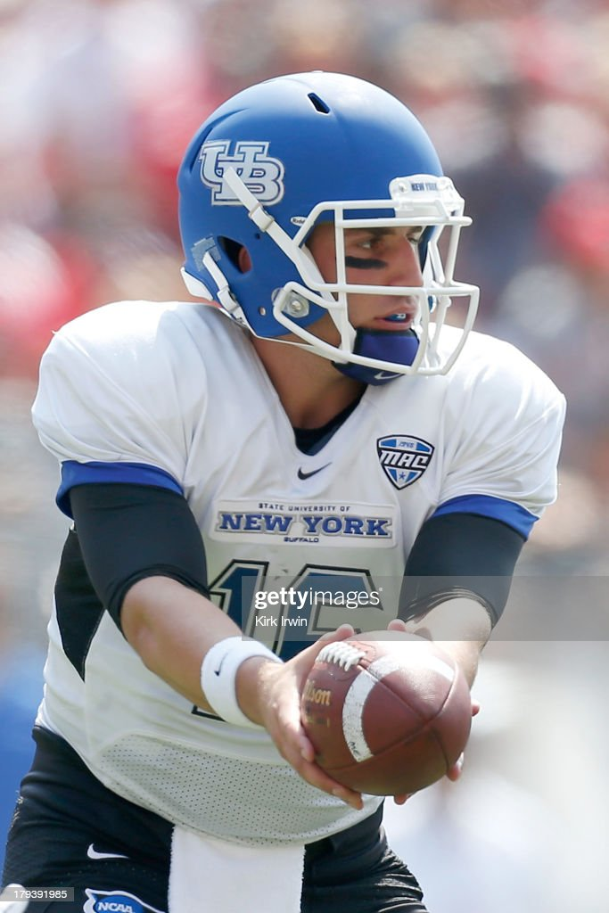 Joe Licata #16 of the Buffalo Bulls hands the ball off to a teammate during the game against the Ohio State Buckeyes on August 31, 2013 at Ohio Stadium in Columbus, Ohio. Ohio State defeated Buffalo 40-20.