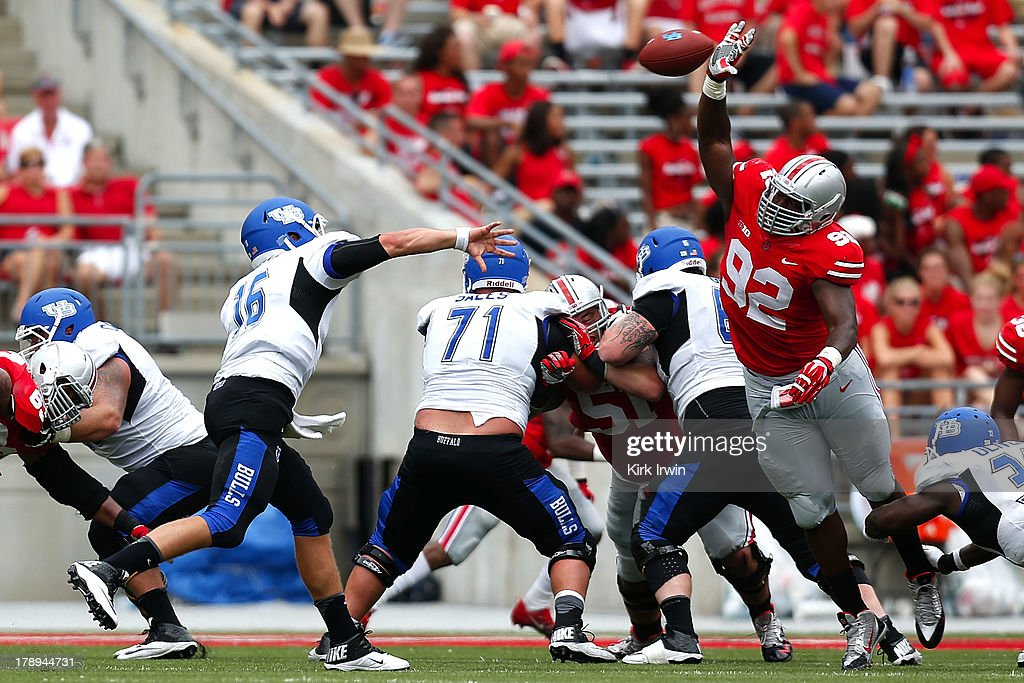 Joe Licata #16 of the Buffalo Bulls throws the ball just past a charging Adolphus Washington #92 of the Ohio State Buckeyes for a touchdown during the third quarter on August 31, 2013 at Ohio Stadium in Columbus, Ohio. Ohio State defeated Buffalo 40-20.