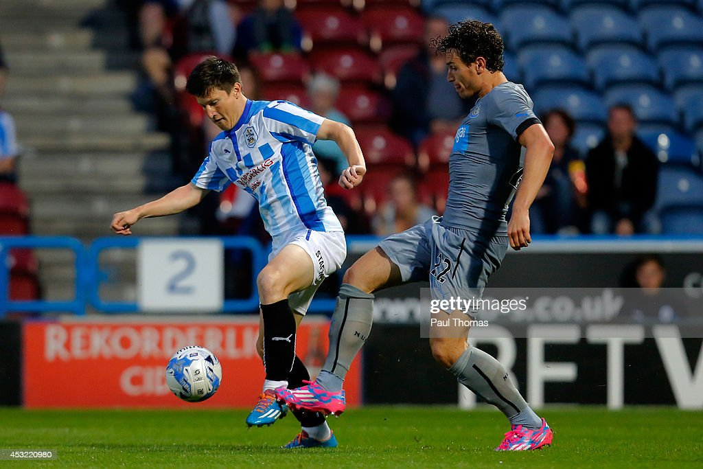 Joe Lolley (L) Of Huddersfield In Action With Daryl