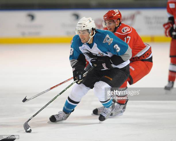 Joe Loprieno of the Worcester Sharks carries the puck against Charlotte Checkers at the DCU Center on November 27 2010 in Worcester Massachusetts