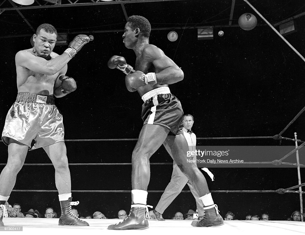 Joe Louis (left) and <a gi-track='captionPersonalityLinkClicked' href=/galleries/search?phrase=Ezzard+Charles&family=editorial&specificpeople=215068 ng-click='$event.stopPropagation()'>Ezzard Charles</a> in action during bout at Yankee Stadium. Charles defeated Louis in 15 rounds to capture the vacant World Heavyweight Title.