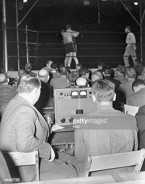 CHAMPIONSHIP '1938 Joe Louis v Max Schmeling' Pictured Spectators press boxers Max Schmeling Joe Louis referee Arthur Donovan during the...