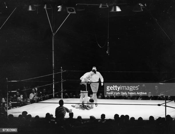 Joe Louis versus Max Schmeling II Donovan directed Louis away from his punchdizzing foe who lies helpless and hopeless on the resin Max was paralyzed...