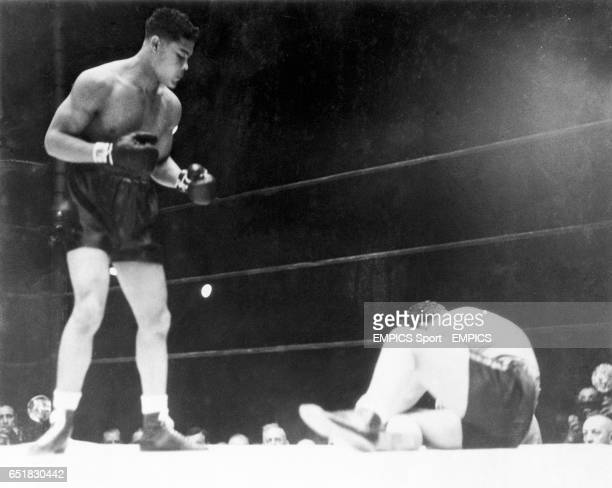 Joe Louis waits for King Levinsky to get to his feet after knocking him down for the second time in the fight