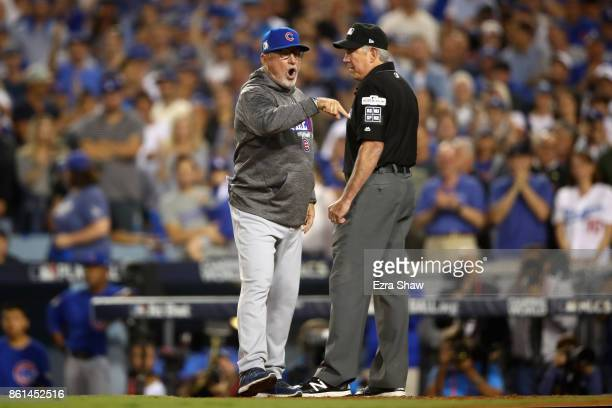 Joe Maddon of the Chicago Cubs argues a call with an umpire in the seventh inning during Game One of the National League Championship Series against...