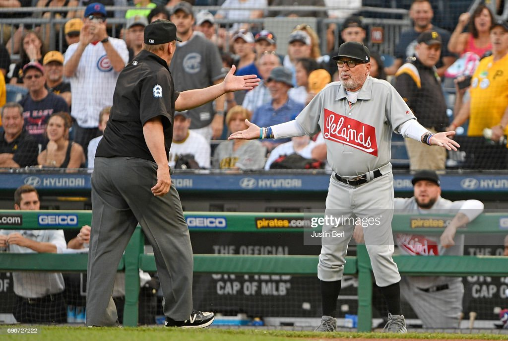 Joe Maddon #70 of the Chicago Cubs argues an overturned call with umpire Jeff Kellogg #8 in the first inning during the game against the Pittsburgh Pirates at PNC Park on June 16, 2017 in Pittsburgh, Pennsylvania. In honor of African American Heritage Night, both teams are wearing throwback uniforms from the Negro League.