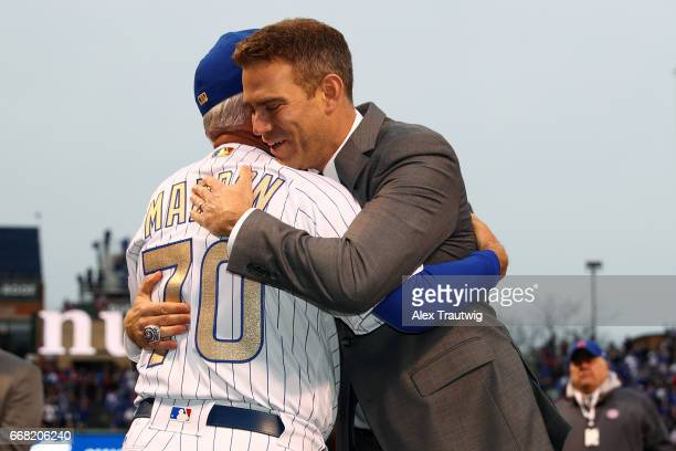 Joe Maddon of the Chicago Cubs is greeted by President of Baseball Operations Theo Epstein during the World Series ring ceremony ahead of the game...