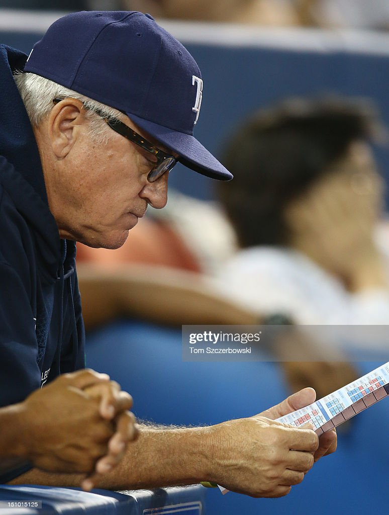 <a gi-track='captionPersonalityLinkClicked' href=/galleries/search?phrase=Joe+Maddon&family=editorial&specificpeople=568433 ng-click='$event.stopPropagation()'>Joe Maddon</a> #70 of the Tampa Bay Rays looks at his lineup card during MLB game action against the Toronto Blue Jays on August 30, 2012 at Rogers Centre in Toronto, Ontario, Canada.