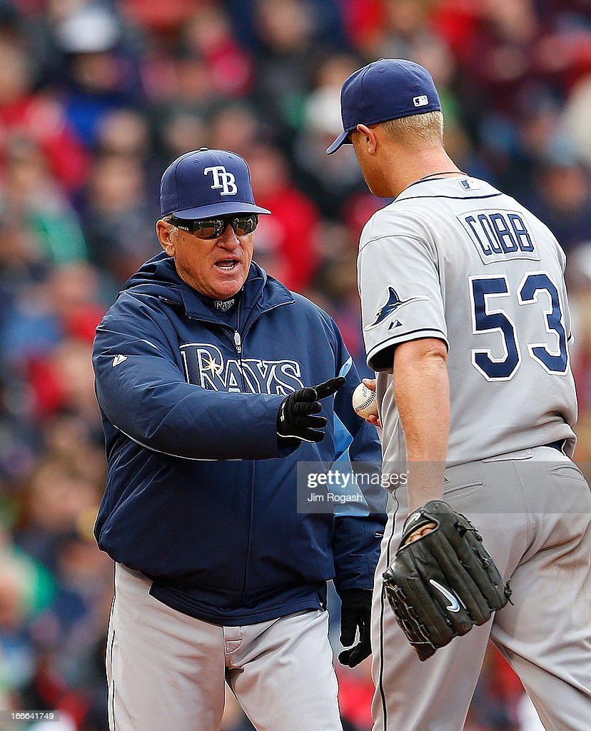 <a gi-track='captionPersonalityLinkClicked' href=/galleries/search?phrase=Joe+Maddon&family=editorial&specificpeople=568433 ng-click='$event.stopPropagation()'>Joe Maddon</a> #70 of the Tampa Bay Rays pulls <a gi-track='captionPersonalityLinkClicked' href=/galleries/search?phrase=Alex+Cobb&family=editorial&specificpeople=7512114 ng-click='$event.stopPropagation()'>Alex Cobb</a> #53 of the Tampa Bay Rays in the seventh inning against the Boston Red Sox at Fenway Park on April 14, 2013 in Boston, Massachusetts.