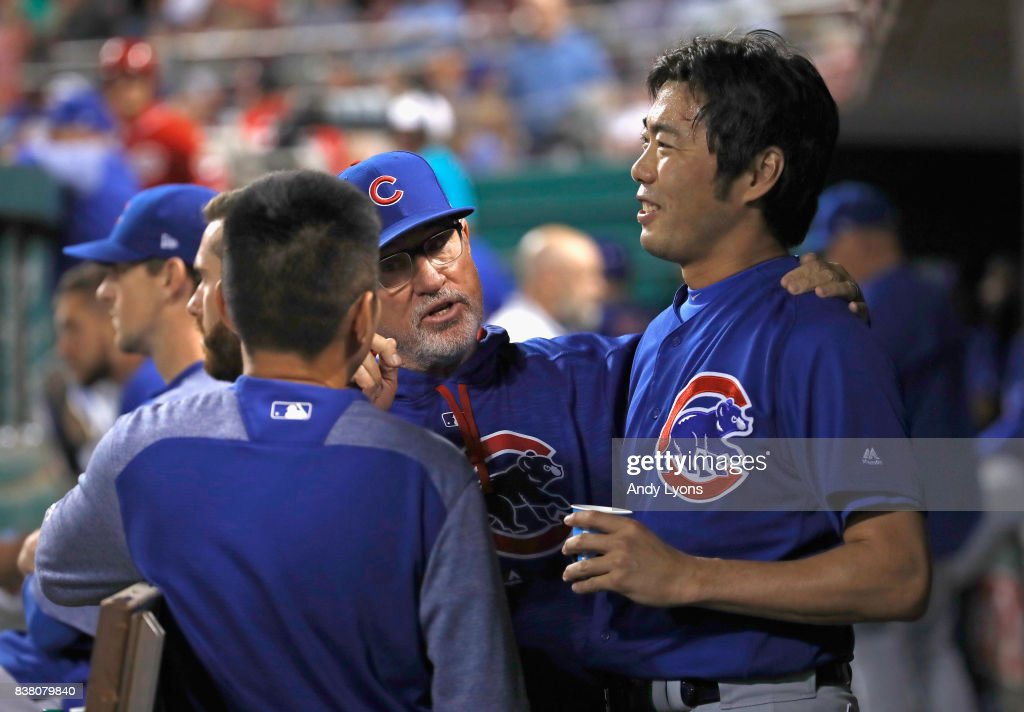 Joe Maddon the manager of the Chicago Cubs talks with Koji Uehara #19 during the game against the Cincinnati Reds at Great American Ball Park on August 23, 2017 in Cincinnati, Ohio.