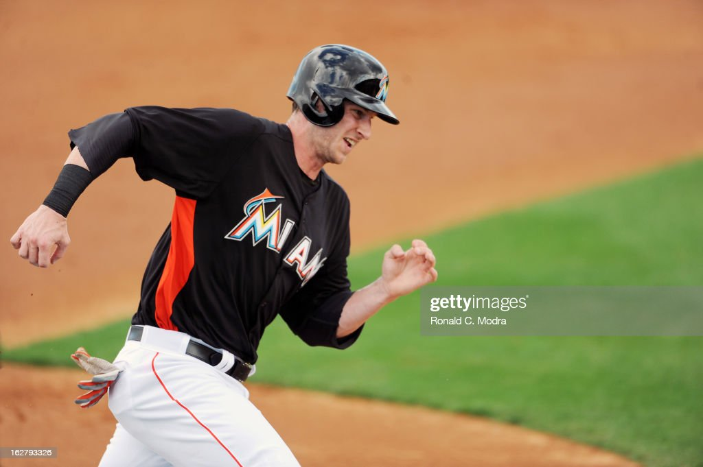 Joe Mahoney #25 of the Florida Marlins runs home during a spring training game against the St. Louis Cardinals at Roger Dean Stadium on February 23, 2013 in Jupiter, Florida.
