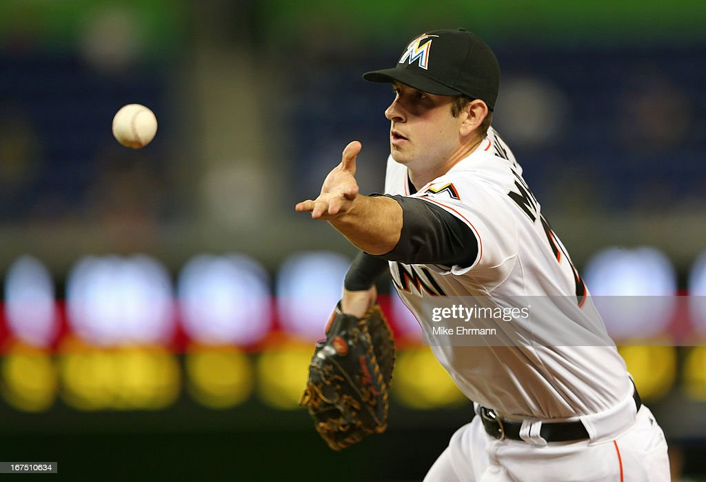 Joe Mahoney #25 of the Miami Marlins makes a toss to first during a game against the Chicago Cubs at Marlins Park on April 25, 2013 in Miami, Florida.