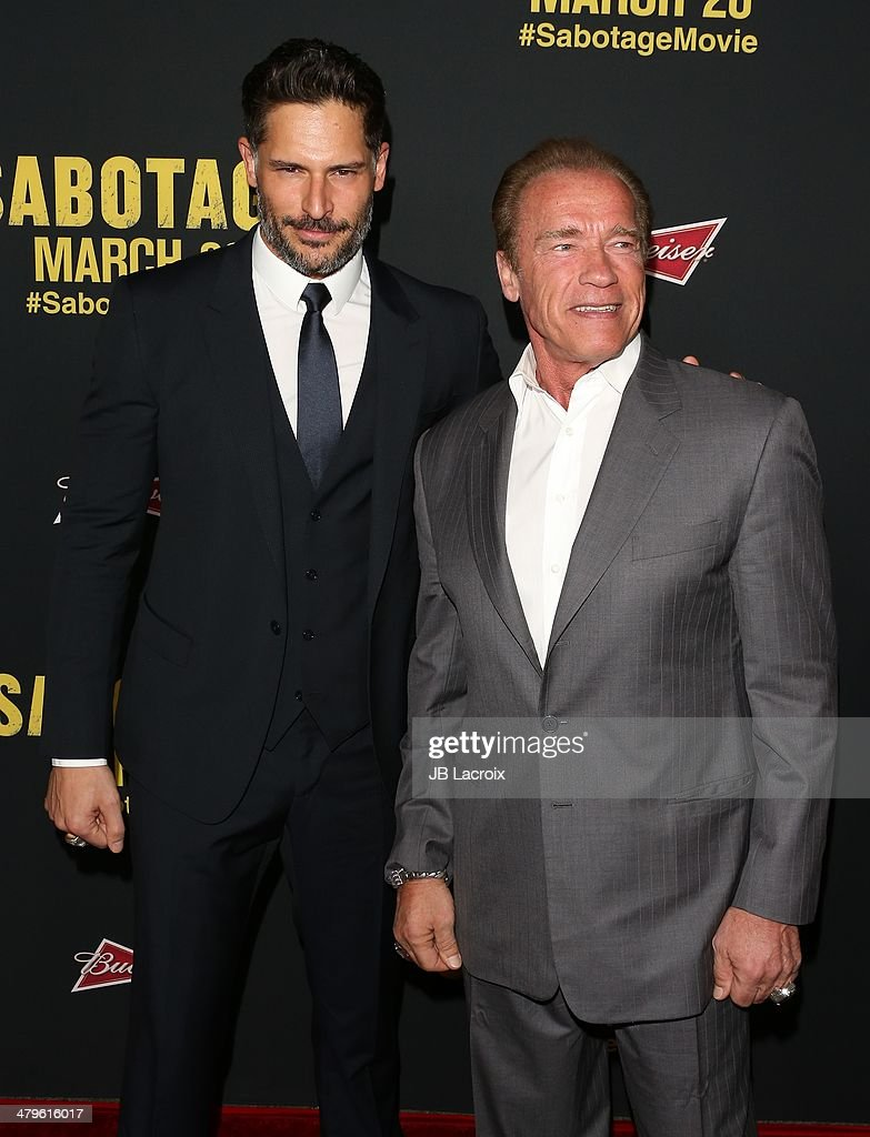 <a gi-track='captionPersonalityLinkClicked' href=/galleries/search?phrase=Joe+Manganiello&family=editorial&specificpeople=2516889 ng-click='$event.stopPropagation()'>Joe Manganiello</a> and <a gi-track='captionPersonalityLinkClicked' href=/galleries/search?phrase=Arnold+Schwarzenegger&family=editorial&specificpeople=156406 ng-click='$event.stopPropagation()'>Arnold Schwarzenegger</a> attend the 'Sabotage' Los Angeles premiere held at Regal Cinemas L.A. Live on March 19, 2014 in Los Angeles, California.