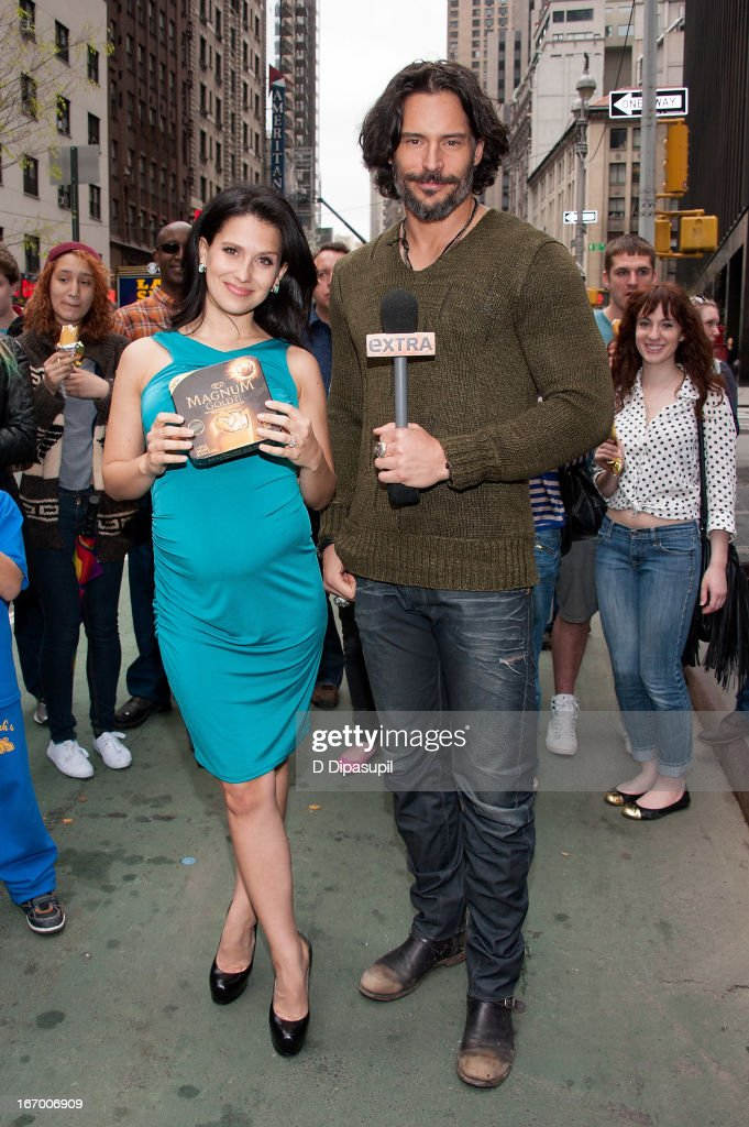 Joe Manganiello (R) and Hilaria Baldwin visit 'Extra' in Times Square on April 19, 2013 in New York City.