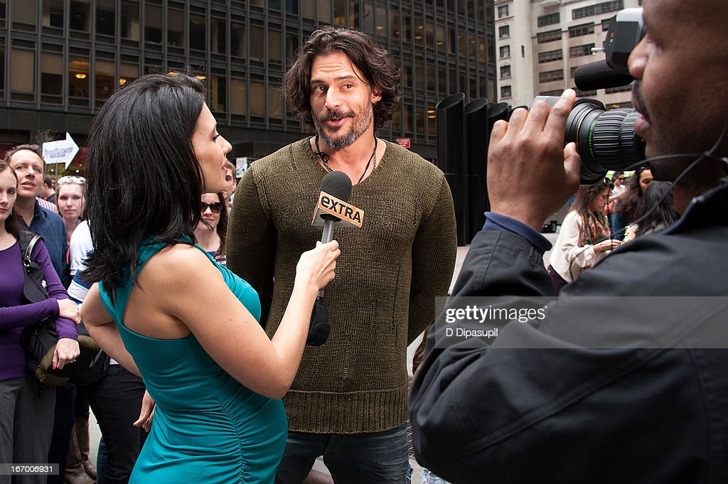 <a gi-track='captionPersonalityLinkClicked' href=/galleries/search?phrase=Joe+Manganiello&family=editorial&specificpeople=2516889 ng-click='$event.stopPropagation()'>Joe Manganiello</a> (C) and Hilaria Baldwin visit 'Extra' in Times Square on April 19, 2013 in New York City.