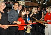 Joe Mantegna left and wife Arlene Mantegna with scissors open her restaurant 'Taste Chicago'
