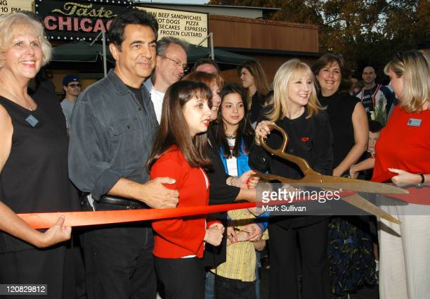 Joe Mantegna left and wife Arlene Mantegna with scissors open her restaurant 'Taste Chicago'