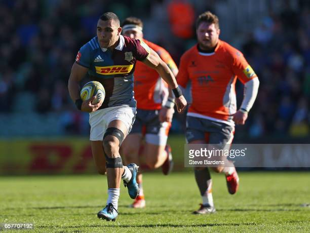 Joe Marchant of Harlequins breaks away to score a try during the Aviva Premiership match between Harlequins and Newcastle Falcons at Twickenham Stoop...