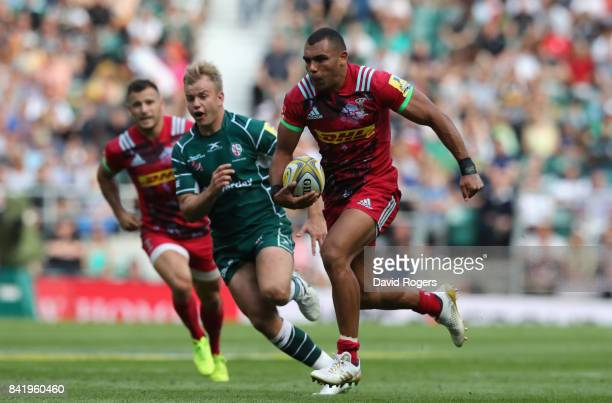 Joe Marchant of Harlequins breaks clear to score a try during the Aviva Premiership match between London Irish and Harlequins at Twickenham Stadium...