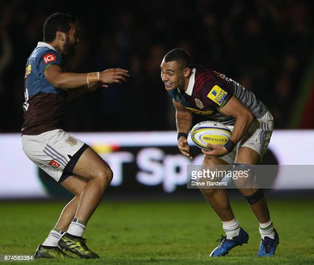 Joe Marchant of Harlequins celebrates scoring a try with Alofa Alofa during the Aviva Premiership match between Harlequins and Wasps at Twickenham...