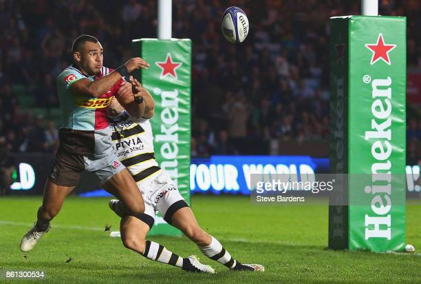 Joe Marchant of Harlequins is beaten by the bounce of the ball as he is about to score a try during the European Rugby Champions Cup match between...