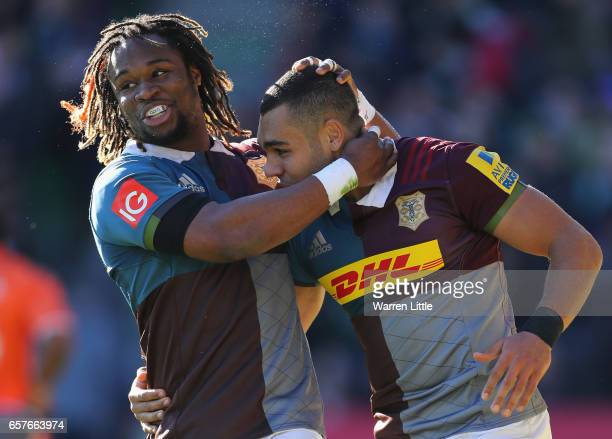 Joe Marchant of Harlequins is congratulated by team mate Marland Yarde after scoring an interception try during the Aviva Premiership match between...