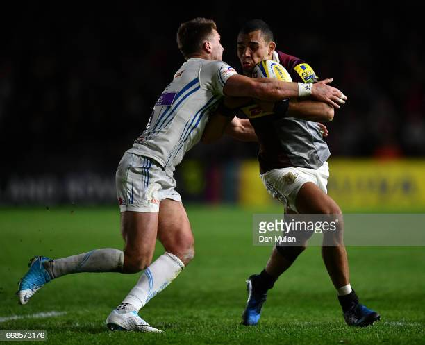 Joe Marchant of Harlequins is tackled by Henry Slade of Exeter Chiefs during the Aviva Premiership match between Harlequins and Exeter Chiefs at...