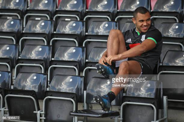 Joe Marchant of Harlequins puts his boots on during a Harlequins training session at Twickenham Stoop on April 13 2017 in London England