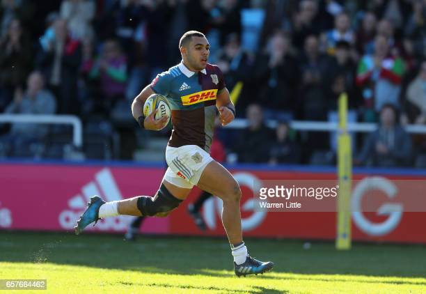 Joe Marchant of Harlequins scores an interception try during the Aviva Premiership match between Harlequins and Newcastle Falcons at Twickenham Stoop...