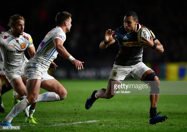 Joe Marchant of Harlequins takes on Henry Slade of Exeter Chiefs during the Aviva Premiership match between Harlequins and Exeter Chiefs at...