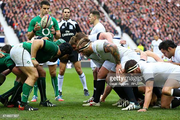 Joe Marler and Tom Wood of England in the scrum during the RBS Six Nations match between England and Ireland at Twickenham Stadium on February 22...