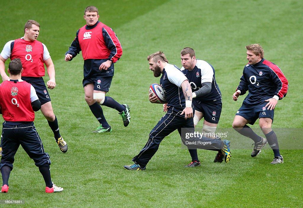 Joe Marler breaks with the ball during the England captain's run at Twickenham Stadium on February 1, 2013 in London, England.