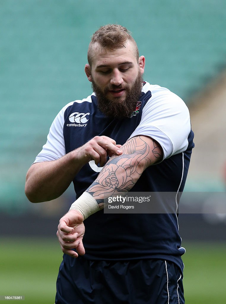 Joe Marler checks his tattoos during the England captain's run at Twickenham Stadium on February 1, 2013 in London, England.