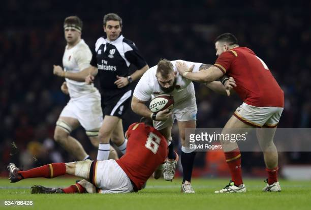 Joe Marler of England is tackled by Sam Warburton and Rob Evans of Wales during the RBS Six Nations match between Wales and England at the...