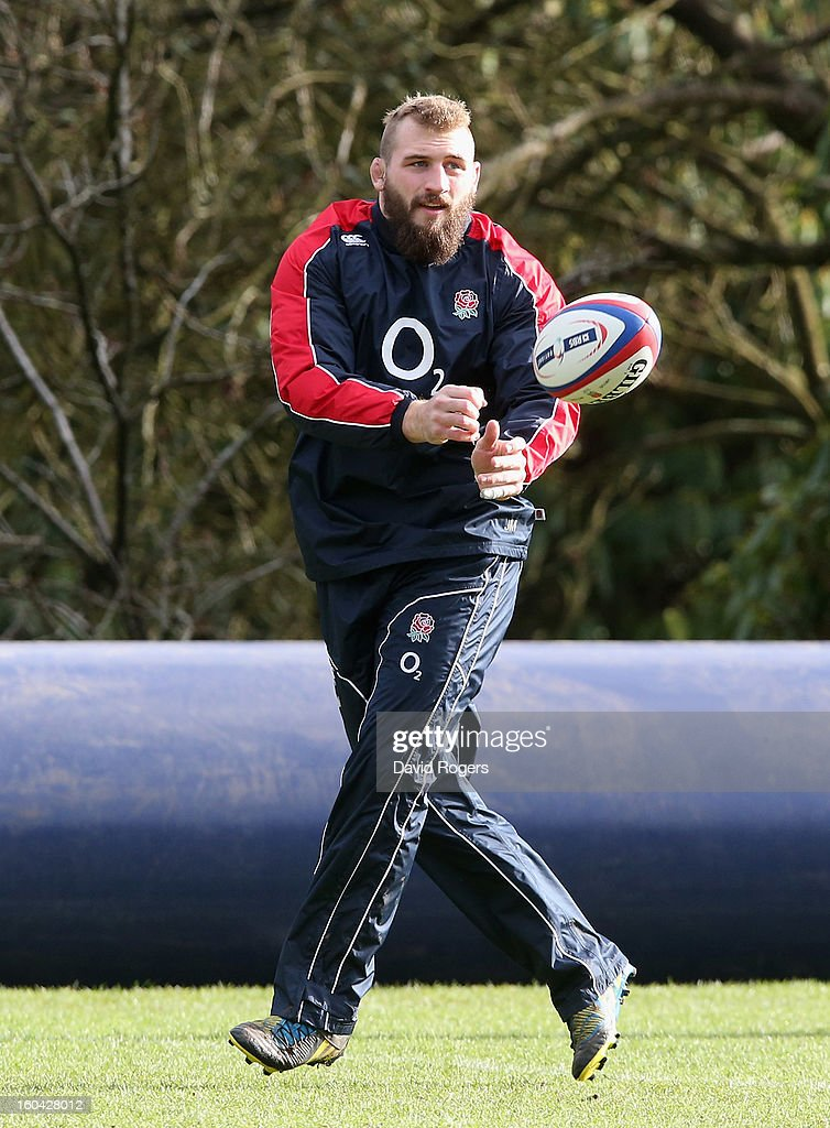 Joe Marler of England passes during an England training session at Pennyhill Park on January 31, 2013 in Bagshot, England.