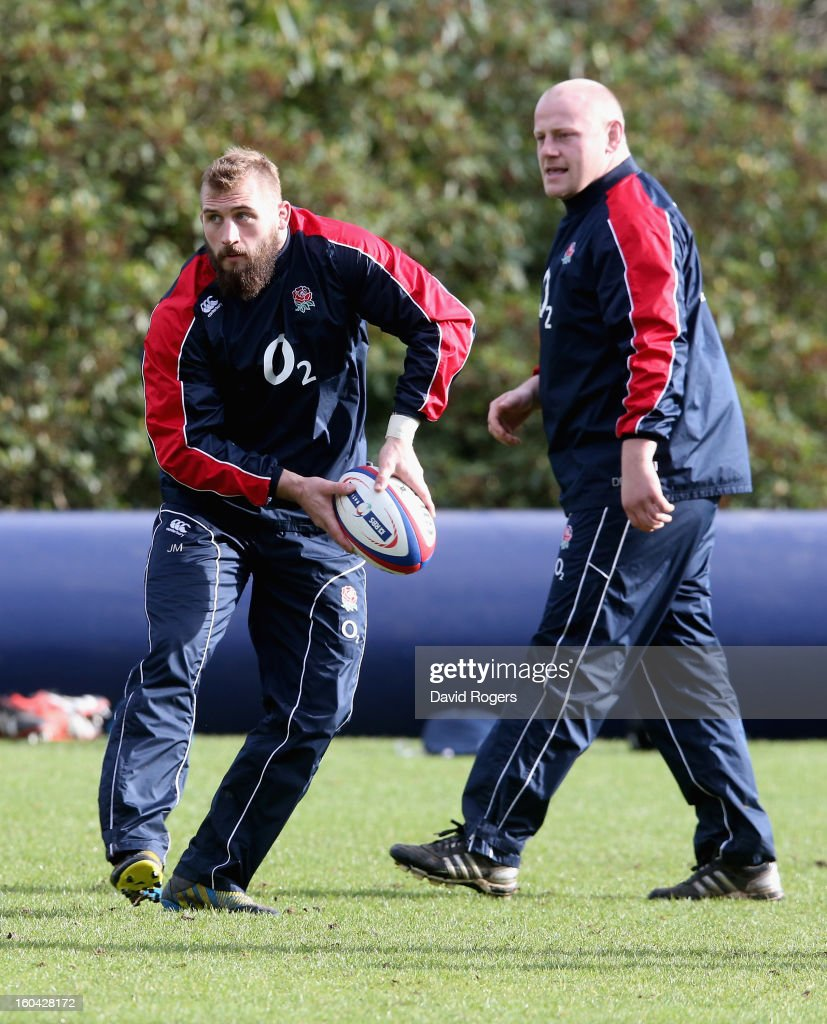 Joe Marler of England passes watched by Dan Cole during an England training session at Pennyhill Park on January 31, 2013 in Bagshot, England.