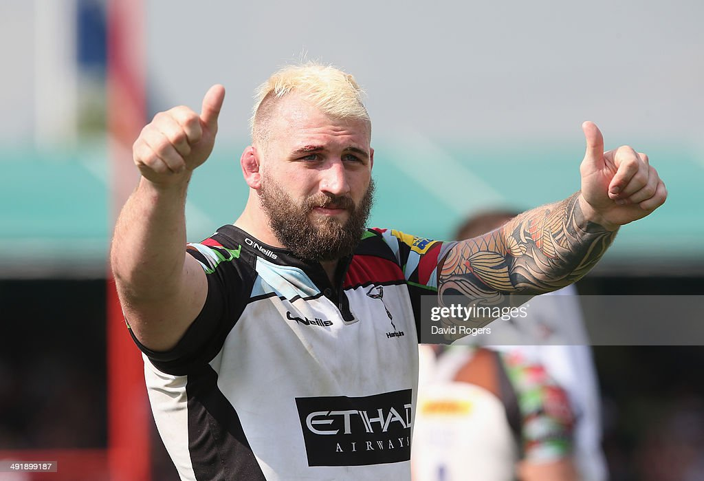 <a gi-track='captionPersonalityLinkClicked' href=/galleries/search?phrase=Joe+Marler&family=editorial&specificpeople=5082292 ng-click='$event.stopPropagation()'>Joe Marler</a> of Harlequins acknowledges the Harlequins fans after their defeat during the Aviva Premiership semi final match between Saracens and Harlequins at Allianz Park on May 17, 2014 in Barnet, England.