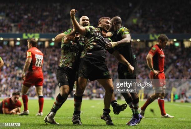 Joe Marler of Harlequins celebrates his try with team mates during the Aviva Premiership match between Harlequins and Saracens at Twickenham Stadium...