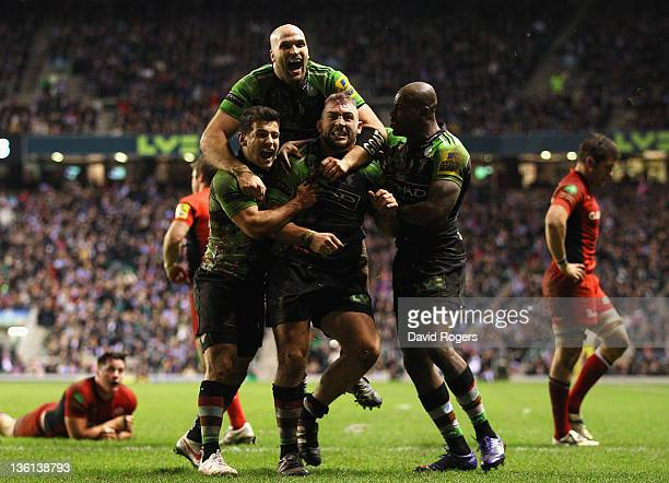 Joe Marler of Harlequins celebrates his try with team mates during the Aviva Premiership match between Harlequins and Saracens at Twickenham Stadium...