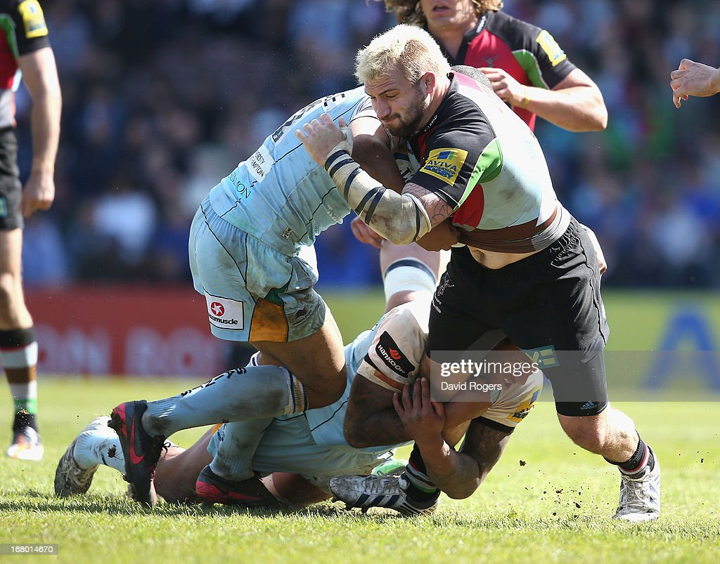 Joe Marler of Harlequins is tackled by <a gi-track='captionPersonalityLinkClicked' href=/galleries/search?phrase=Courtney+Lawes&family=editorial&specificpeople=5385543 ng-click='$event.stopPropagation()'>Courtney Lawes</a> and <a gi-track='captionPersonalityLinkClicked' href=/galleries/search?phrase=Luther+Burrell&family=editorial&specificpeople=871965 ng-click='$event.stopPropagation()'>Luther Burrell</a> during the Aviva Premiership match between Harlequins and Northampton Saints at Twickenham Stoop on May 4, 2013 in London, England.