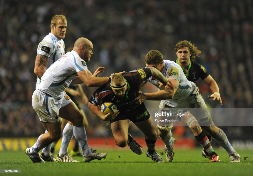 Joe Marler of Harlequins is tackled by Damien Welch of Exeter Chiefs during the Aviva Premiership match between Harlequins and Exeter Chiefs at Twickenham Stadium on December 28, 2013 in London, England.