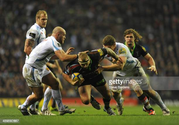 Joe Marler of Harlequins is tackled by Damien Welch of Exeter Chiefs during the Aviva Premiership match between Harlequins and Exeter Chiefs at...