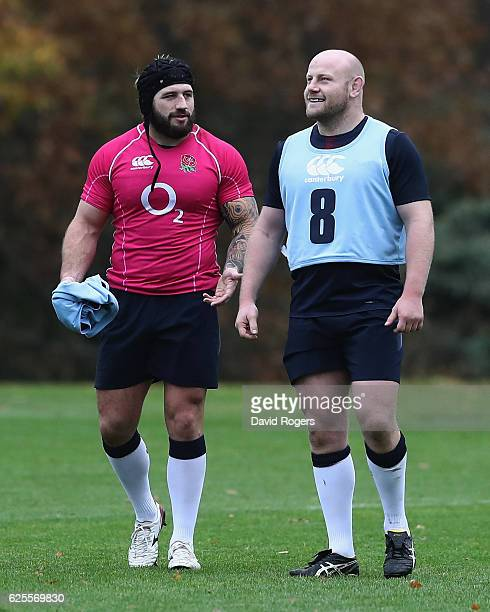 Joe Marler talks to team mate and fellow prop Dan Cole during the England training session held at Pennyhill Park on November 24 2016 in Bagshot...